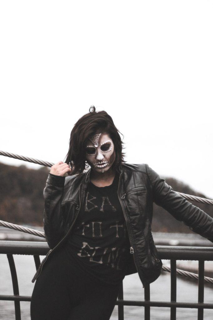 Woman in Grey Halloween Mask