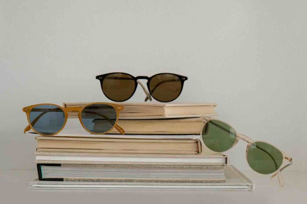 Oliver Peoples Sunglasses on a stack of books